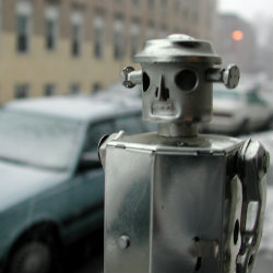 Robot Frets Over Moral Puzzle, Humans Die